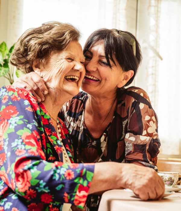 Two women laughing and smiling